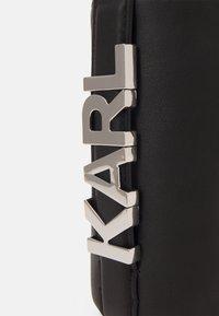 KARL LAGERFELD - LETTERS BOTTLE HOLDER - Across body bag - black - 3