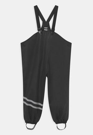 MINI RAIN LINED UNISEX - Rain trousers - black