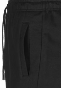 Puma - UNITY  - Sports shorts - black - 2