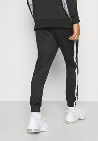 Ellesse - LOBIAT - Tracksuit bottoms - black - 2