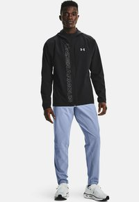 Under Armour - OUTRUN THE STORM - Trousers - washed blue - 1