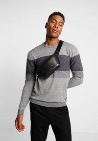 Calvin Klein - DIRECT WAISTBAG - Bum bag - black - 1