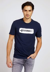 Guess - T-shirt con stampa - blau - 0