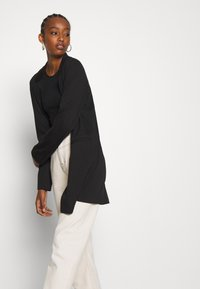 Vero Moda - VMCHLOE LONG BOO - Short coat - black - 4