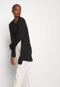 Vero Moda - VMCHLOE LONG BOO - Krátký kabát - black - 4