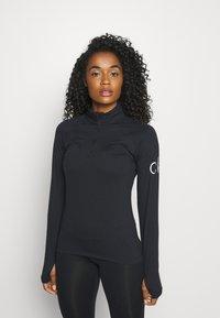 Calvin Klein Golf - VIBE HALF ZIP LAYERING - Long sleeved top - black - 0