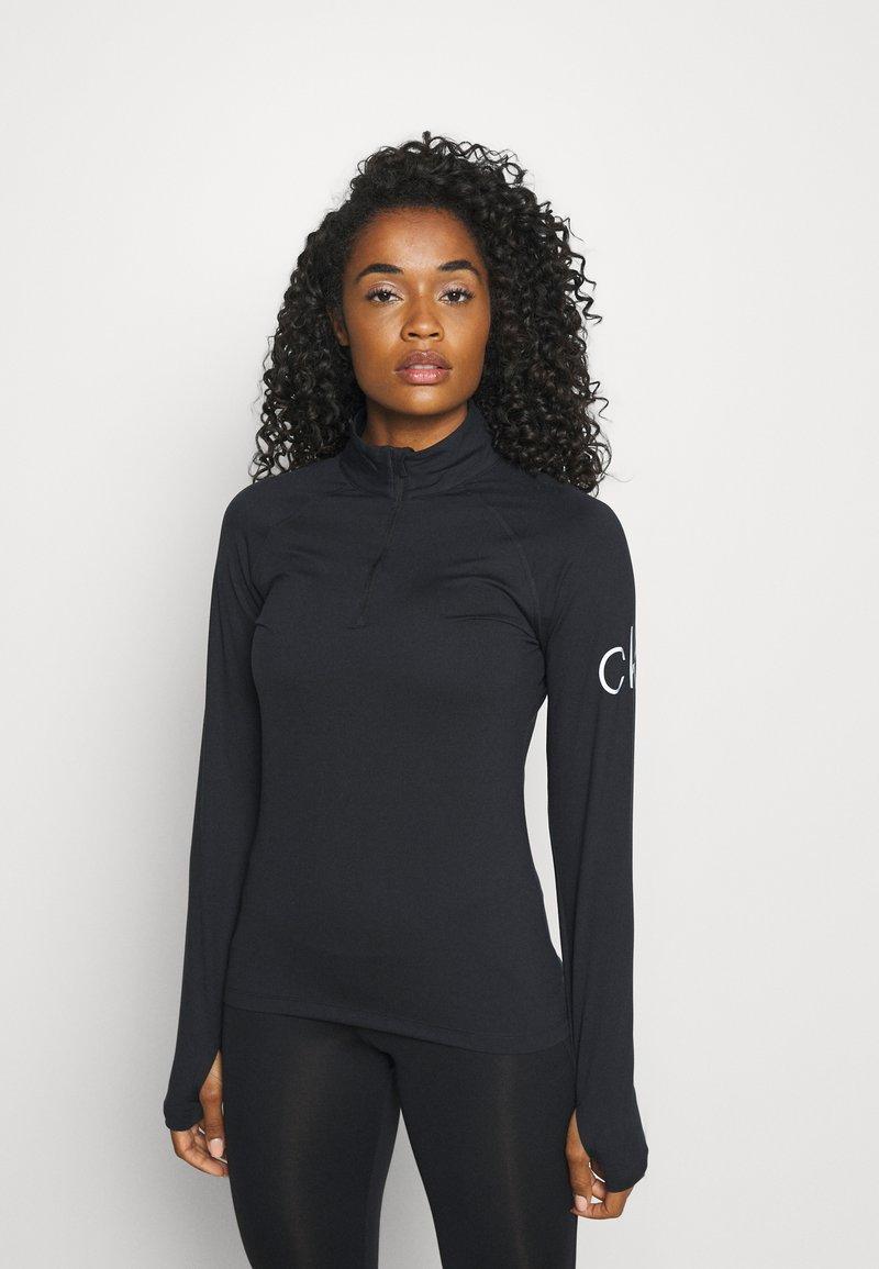 Calvin Klein Golf - VIBE HALF ZIP LAYERING - Long sleeved top - black