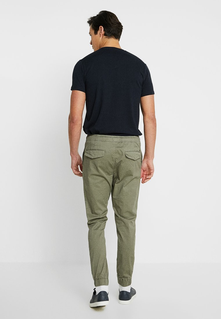 Solid TRUC CUFF - Trousers - dusty oliv kEgLx