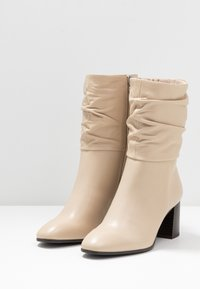 Tamaris - Classic ankle boots - ivory - 4