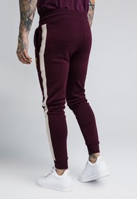 SIKSILK - CUT AND SEW TAPED PANTS - Verryttelyhousut - burgundy/cream - 2