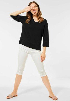 OVER - Long sleeved top - schwarz