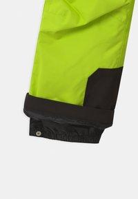Reima - WINTER TAKEOFF UNISEX - Zimní kalhoty - lime green - 4