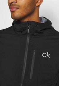 Calvin Klein Golf - ULTRON HOODED JACKET - Waterproof jacket - black - 4