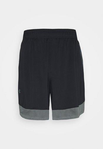 TRAIN - Sports shorts - black