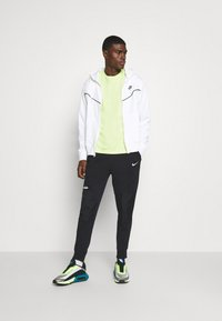 Nike Sportswear - AIR PANT  - Tracksuit bottoms - black/white - 1