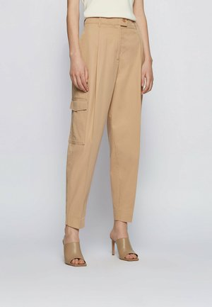 TAWAKOS - Cargo trousers - beige