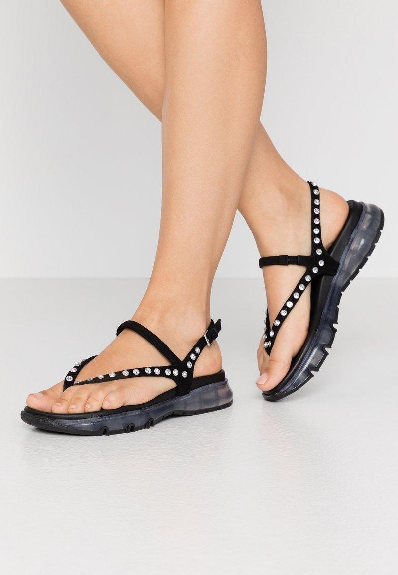 Toral - Sandaalit nilkkaremmillä - black