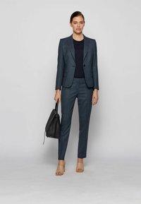 BOSS - TILUNA - Trousers - patterned - 1