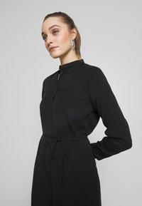 Calvin Klein - BELTED MIDI DRESS - Shirt dress - black - 4