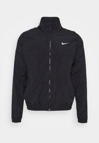 Nike Performance - STARTING - Chaqueta de entrenamiento - black/white - 4