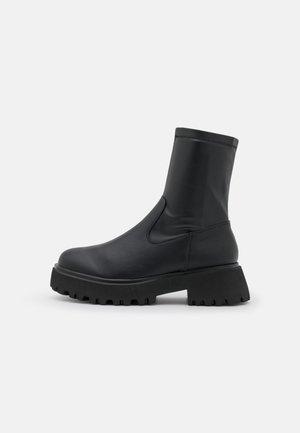 VEGAN FIERRCE - Platform ankle boots - black