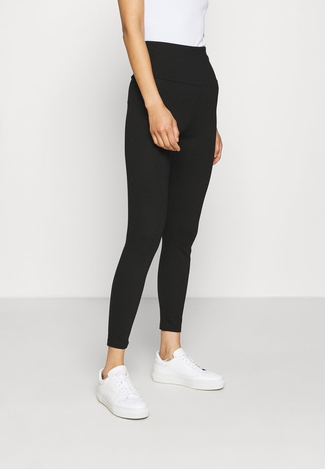 HIGH WAIST - Trousers - black