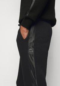 Colmar Originals - PANTS - Tracksuit bottoms - black - 5