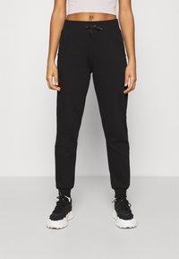 New Look - SLIM LEG JOGGER - Tracksuit bottoms - black - 0