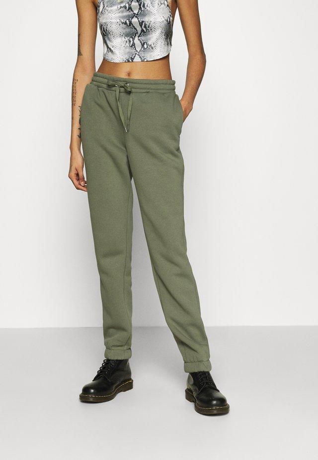 NMNORA - Teplákové kalhoty - dusty olive