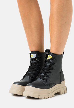 VEGAN ASPHA - Platform ankle boots - black/cream