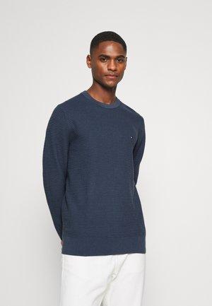 Stickad tröja - faded indigo