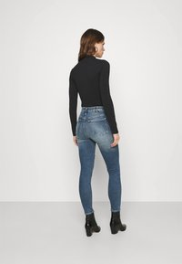 Calvin Klein Jeans - MICRO BRANDING - Long sleeved top - black - 2