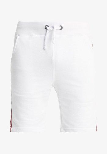 TAPE JOGGER - Tracksuit bottoms - white