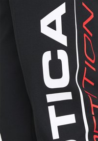 NAUTICA COMPETITION - PINISI - Tracksuit bottoms - black - 2