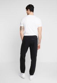 adidas Originals - POLAR PANT - Trainingsbroek - black/silver - 2