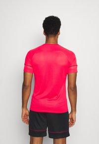 Nike Performance - ACADEMY 21 - Print T-shirt - siren red/black - 2