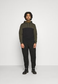Calvin Klein Jeans - TECHNICAL - Cargo trousers - black - 1