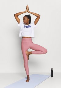 Puma - STUDIO LUXE ECLIPSE - Tights - foxglove heather