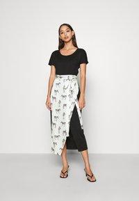 Never Fully Dressed - BLACK ZEBRA LOUNGE WRAP DRESS - Day dress - black - 0