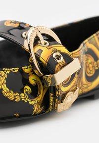 Versace Jeans Couture - Ankle strap ballet pumps - black - 6