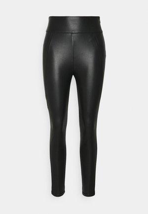 VINNIS COATED - Trousers - black