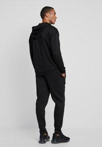 Urban Classics - CUT AND SEW PANTS - Tracksuit bottoms - black - 2