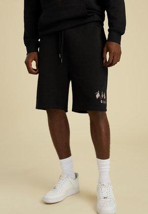 TUNNELZUG - Shorts - schwarz