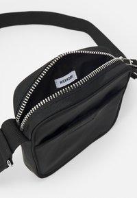 Weekday - JESSIE CROSSBODY - Across body bag - black - 2