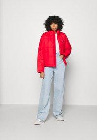 adidas Originals - PUFFER WINTER MIDWEIGHT JACKET - Light jacket - scarlet - 1