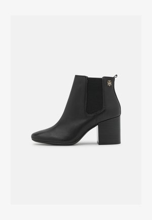 ESSENTIALS - Ankle boots - black