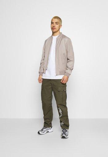 PANTS UNISEX - Cargo trousers - khaki