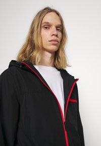 Ellesse - BOLAZIONI WINDRUNNER - Summer jacket - black - 3