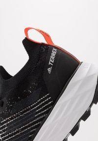 adidas Performance - TERREX TWO PARLEY - Trail running shoes - core black/grey three/true orange - 5