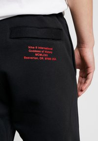 Nike Sportswear - Pantalones deportivos - black/white - 6
